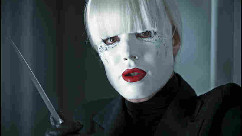 Is that Noomi Rapace's Isabelle behind the mask (and the knife)? Could be. Probably is. Passion is nothing if not a genre flick — though genre films do come with their twists.