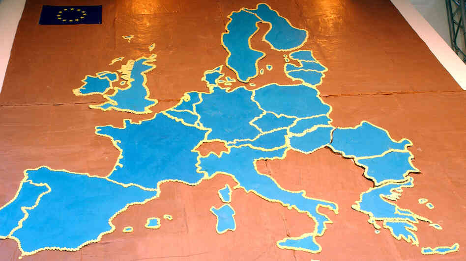 A chocolate cake is shaped like Europe, with new EU members Romania and Bulgaria (far right), at a welcoming ceremony for their entry into the bloc on Dec. 14, 2006. Curbs on the movement of citizens of the two countries end on Jan. 1, raising fears in Western Europe of an influx of Bulgarian and Romanian workers.