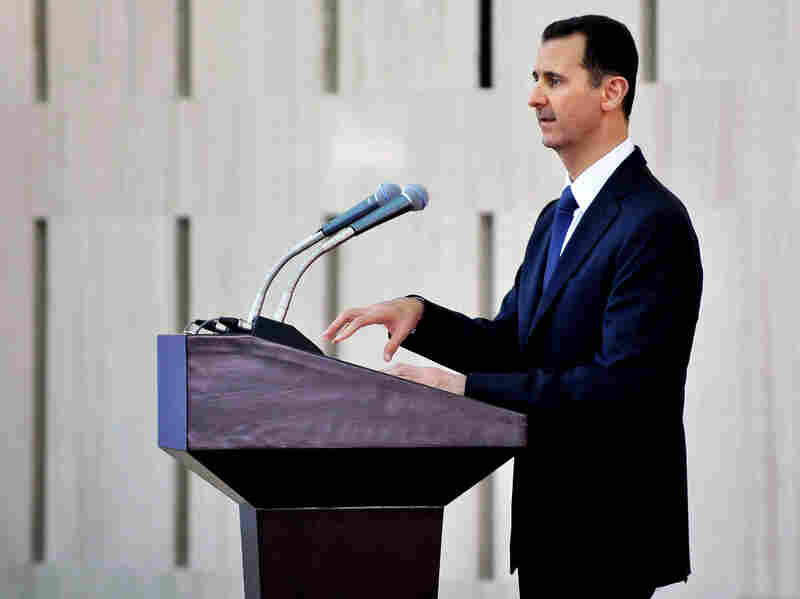 Syrian President Bashar Assad delivers a speech at an iftar dinner with political and religious figures in Damascus, Syria, on Aug. 4. In Syria, many different religious groups live in an often uneasy mix. While the country is primarily Sunni Arab, the government is run by minority Alawites like Assad — adherents of an offshoot of Shiite Islam.