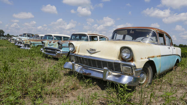 Chevrolets are lined up in a field near the Lambrecht Chevrolet dealership in Pierce, Neb. Later this month, bidders will attend a two-day auction that will feature about 500 old cars and trucks, many with fewer than 10 miles on the odometer. (AP)