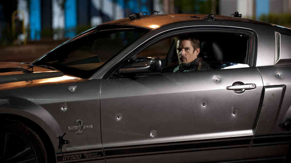 Ethan Hawke headlines the picture, along with Selena Gomez, but it's still pretty much a movie about a car. Which for some reason is largely bulletproof.