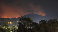 Flames from the Rim Fire in the hills behind Tuolumne City, Calif., on Wednesday.