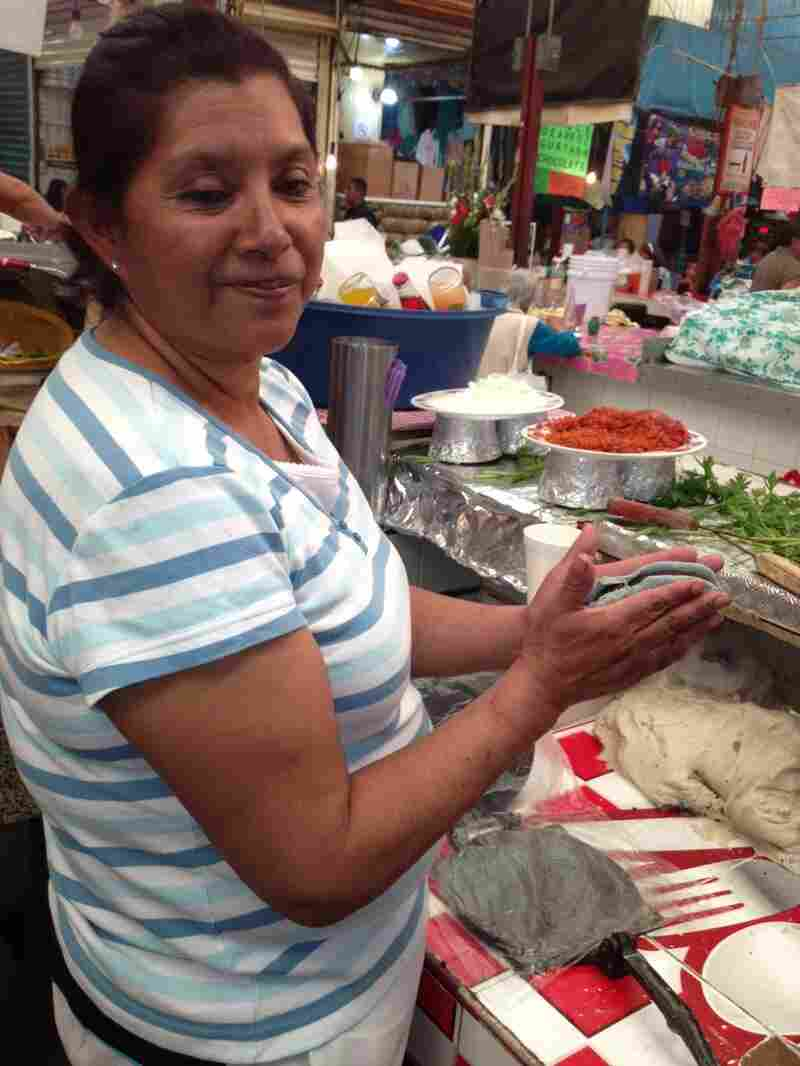 Isabel Salazar Cabrera says her tlacoyos are the best because of the way she cooks the bean filling. She says her mom was the first to ever sell tlacoyos in Xochimilo, a suburb in southern Mexico City.