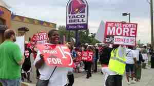Outside a Taco Bell restaurant in Warren, Mich., early Thursday, supporters of the push by fast-food workers to raise the minimum wage were marching.