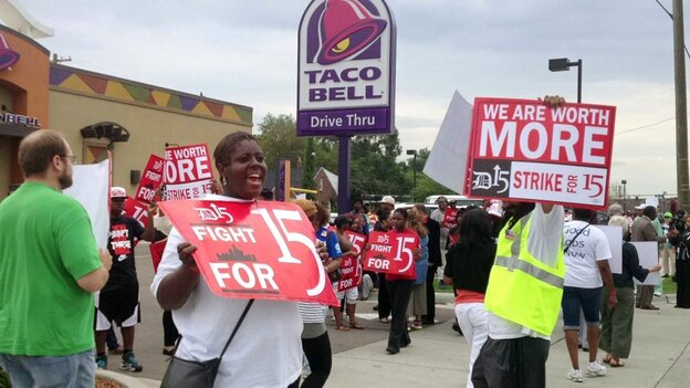 Outside a Taco Bell restaurant in Warren, Mich., early Thursday, supporters of the push by fast-food workers to raise the minimum wage were marching. (MCT/Landov)