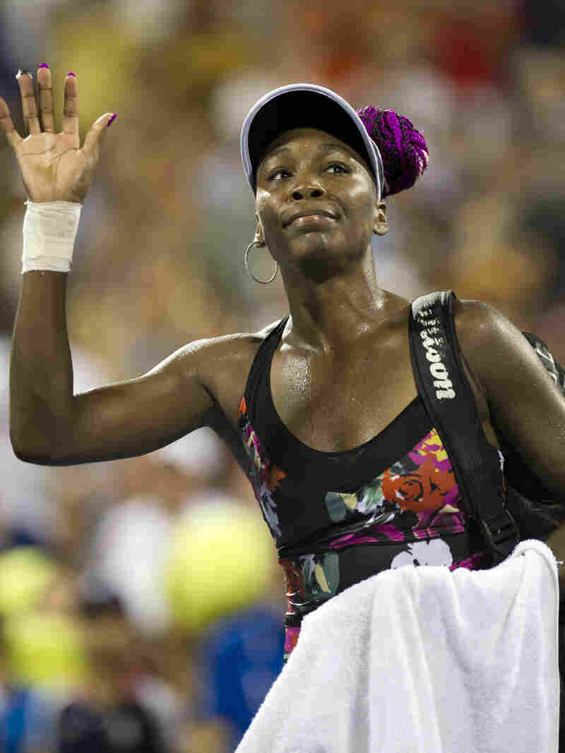 Venus Williams waves to tennis fans as she leaves the court after a three-hour loss to Zheng Jie of China in the U.S. Open's second round.