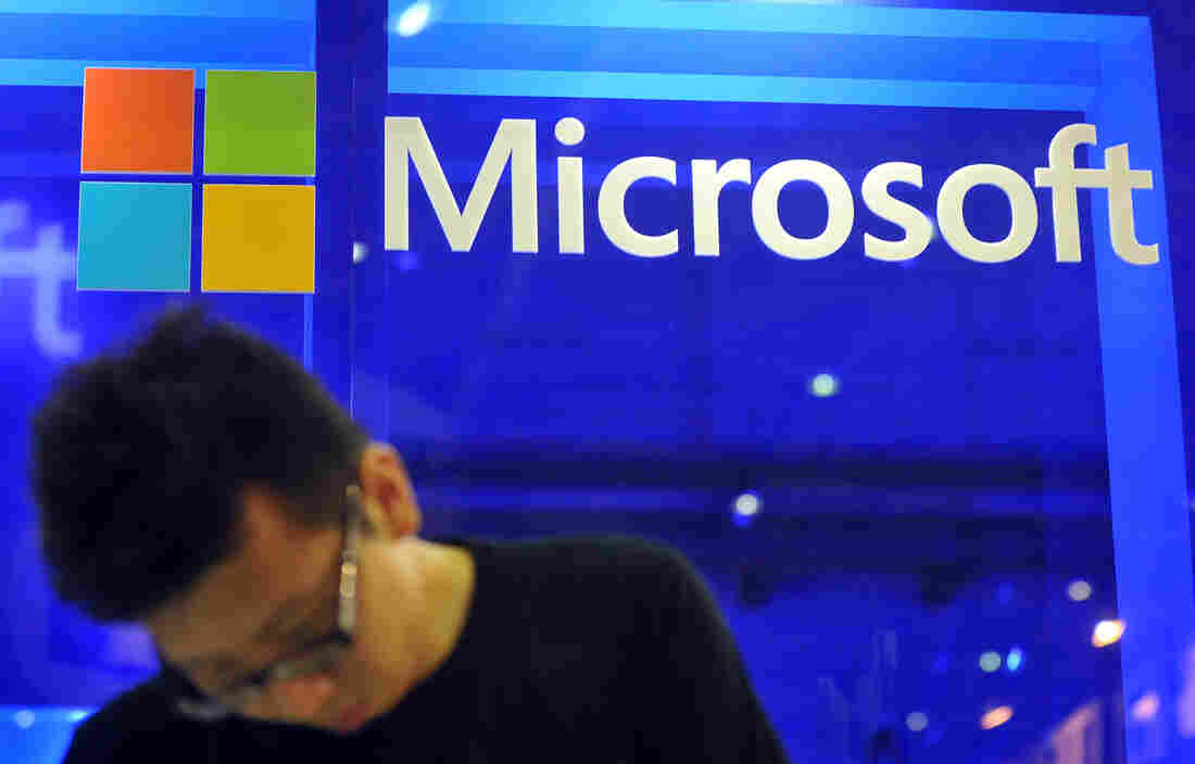 An employee stands at the Microsoft booth during the 2013 Computex in Taipei on June 4, 2013.