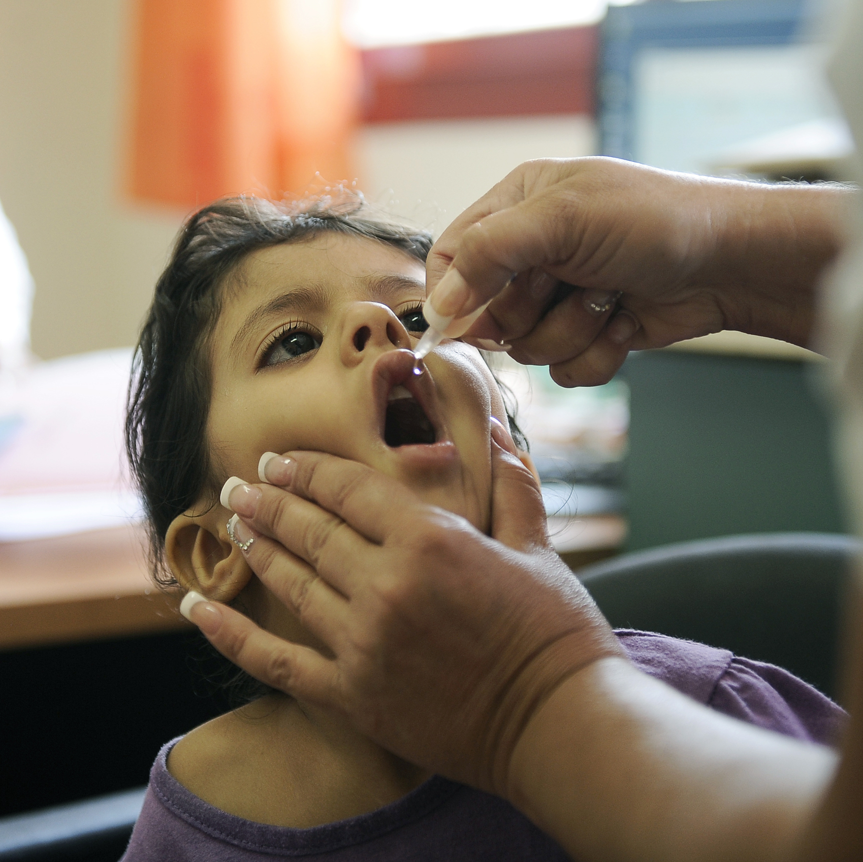 A child gets a polio vaccination at a clinic in Rahat, Israel, in August.