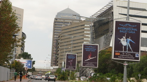 Billboards advertise a ballet gala in the affluent neighborhood of Sandton, Johannesburg — a recurring setting in Mackenzie's books.
