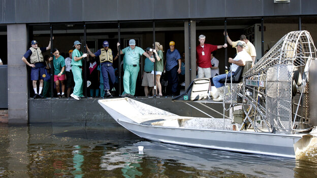 An airboat pulls up to the Memorial Medical Center in New Orleans on Wednesday, Aug. 31, 2005.