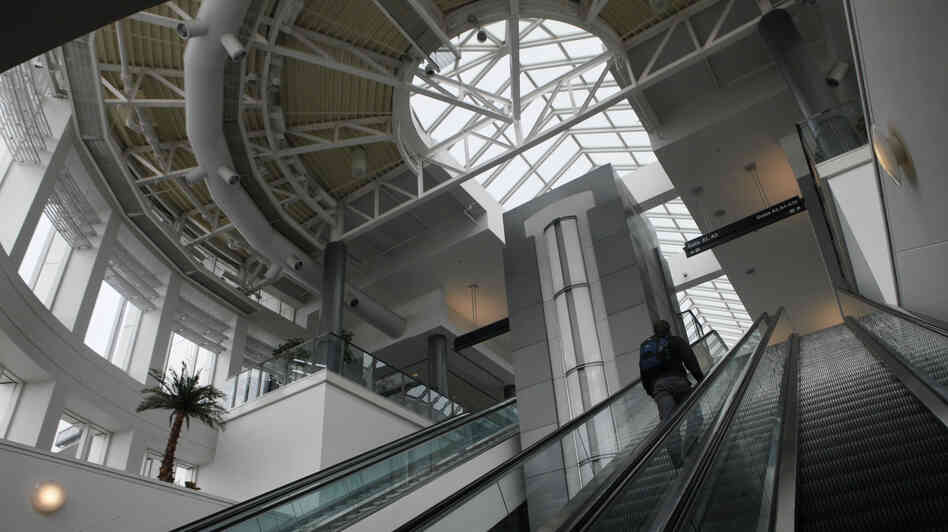 A passenger rides an escalator to Terminal A at the Cincinnati/Northern Kentucky International Airport in Erlanger, Ky.