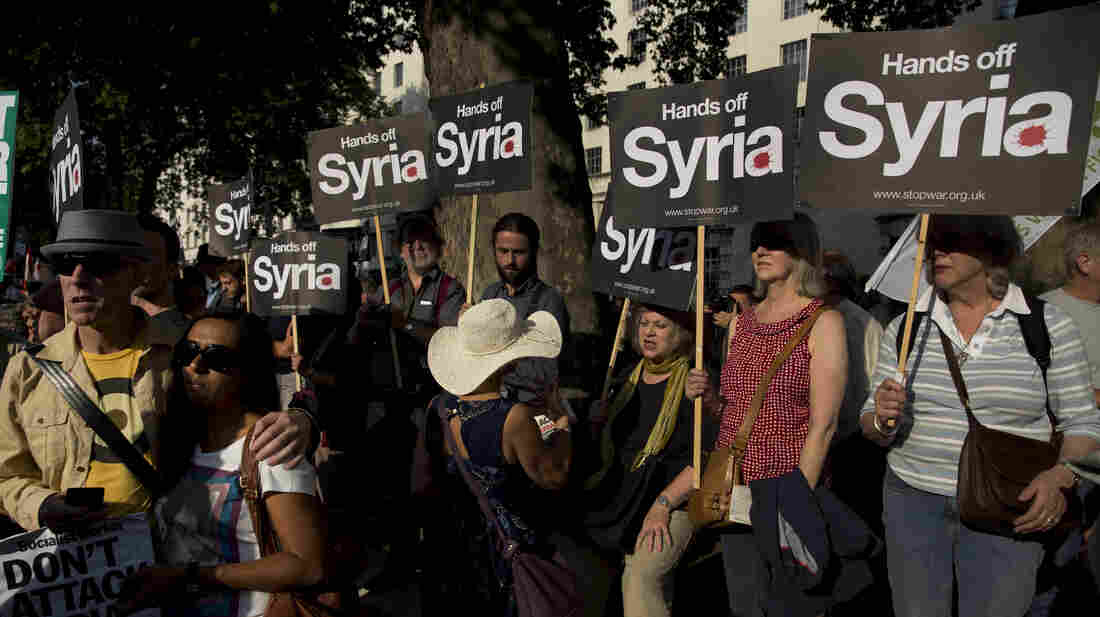 Anti-war protesters rally outside Downing Street in London on Wednesday. Britain's Parliament rejected the country's involvement in any military action against Syria. The U.