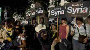 Anti-war protesters rally outside Downing Street in London on Wednesday. Britain's Parliament rejected the country's involvement in any military action against Syria. The U.K. government had been among those seeking a strong response to the alleged use of chemical weapons in Syria.