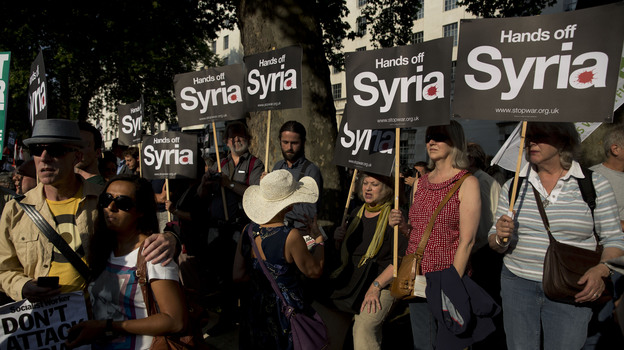 Anti-war protesters rally outside Downing Street in London on Wednesday. Britain's Parliament rejected the country's involvement in any military action against Syria. The U.K. government had been among those seeking a strong response to the alleged use of chemical weapons in Syria. (AP)