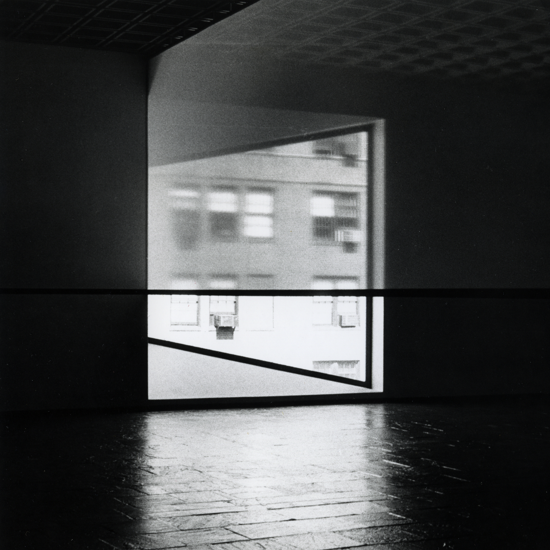 A photo from the 1977 debut of Robert Irwin's Scrim Veil--Black Rectangle--Natural Light at the Whitney Museum of American Art.