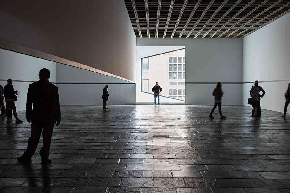 Visitors explore Robert Irwin's Scrim Veil--Black Rectangle--Natural Light during its 2013 reprise at the Whitney Museum of American Art.