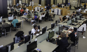 Users take advantage of the technology made available to them at the Martin Luther King Jr. Memorial Library.