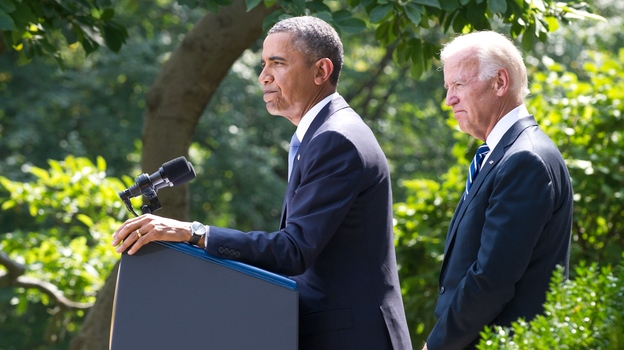 President Obama speaks in the White House Rose Garden on Saturday, joined by Vice President Biden, to announce that he wants congressional approval to attack Syria. (AFP/Getty Images)