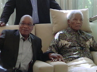 In an image taken from video, South African President Jacob Zuma, left, sits with the ailing anti-apartheid icon Nelson Madela in April.