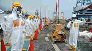 This photo taken Aug. 6 shows local government officials and nuclear experts at Fukushima after contaminated water was discovered.