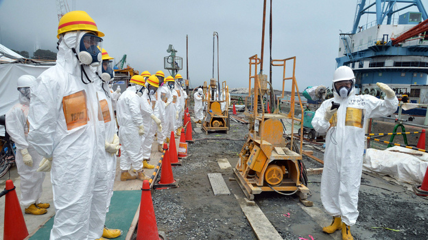 This photo taken Aug. 6 shows local government officials and nuclear experts at Fukushima after contaminated water was discovered. (AFP/Getty Images)