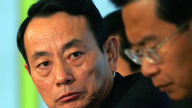 Jiang Jiemin, left, is the latest Chinese official to come under scrutiny for possible corruption. (Associated Press)
