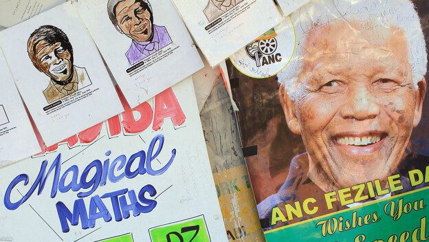 A portrait of former South African President Nelson Mandela with get well messages Saturday outside the hospital where he was treated for a lung infection. (AP)