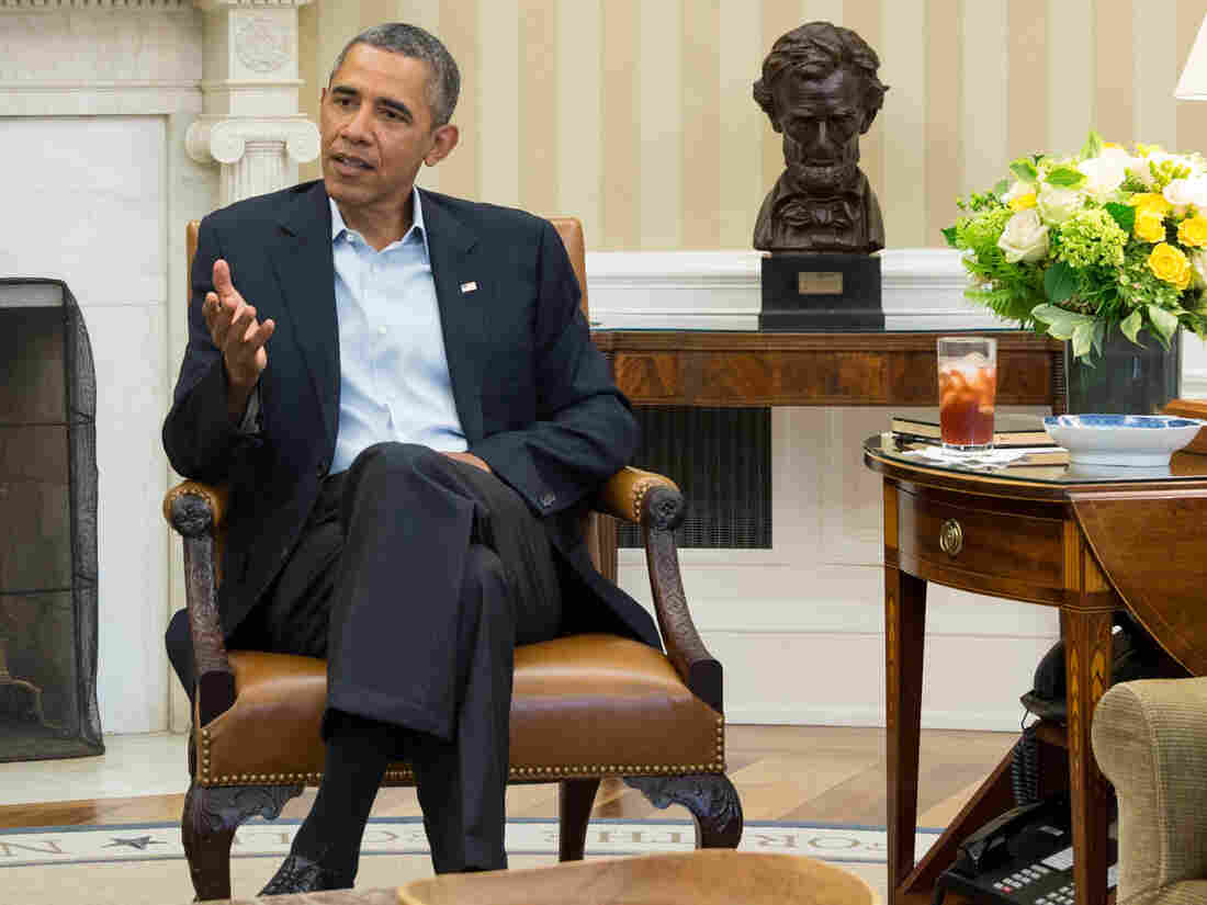President Obama discusses Syria options in the Oval Office of the White House on Monday.