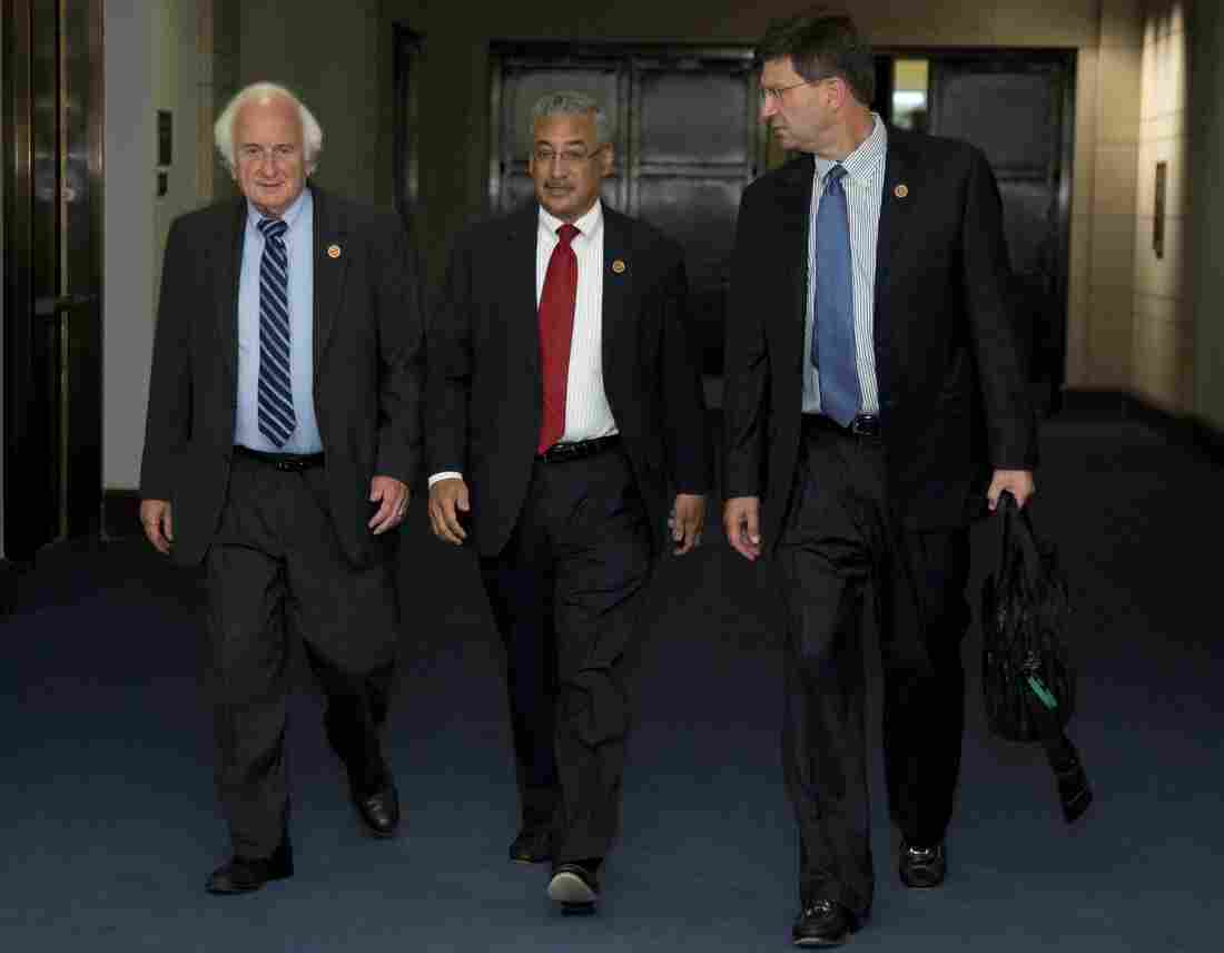 From left, Rep. Sander Levin, D-Mich., Rep. Robert Scott, D-Va., and Rep. Brad Schneider, D- ll., walk to a closed members-only briefing on Syria on Sunday.