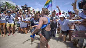 United States endurance swimmer Diana Nyad is greeted by a crowd as she walks on to the Key West, Fla., shore today.