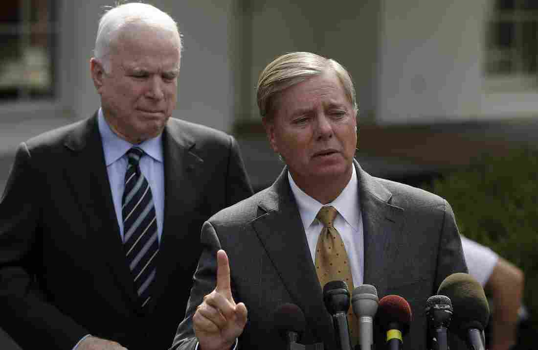 Lindsay Graham, R-S.C., right, accompanied by Sen. John McCain, R-Ariz., speaks Monday following a White House meeting with President Obama. Both senators are calling for a tough military response against Syria.