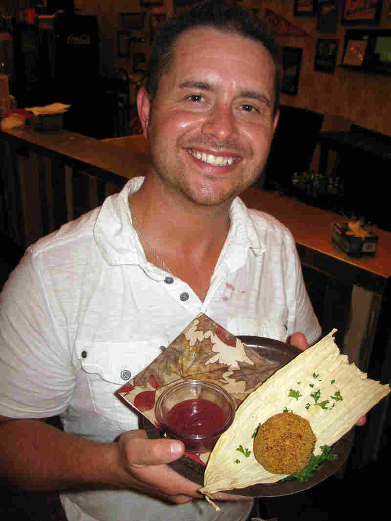 """Justin Martinez runs the Lone Star Roadhouse inside the fairgrounds. His Thanksgiving dinner is stuffing and diced turkey dipped in Southern-style creamed corn and rolled in cornmeal. He won """"Most Creative"""" in the 2013 Big Tex Choice Awards."""