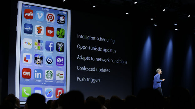 Craig Federighi, senior vice president of software engineering at Apple, discusses features of the new iOS 7 during the keynote address of the Apple Worldwide Developers Conference