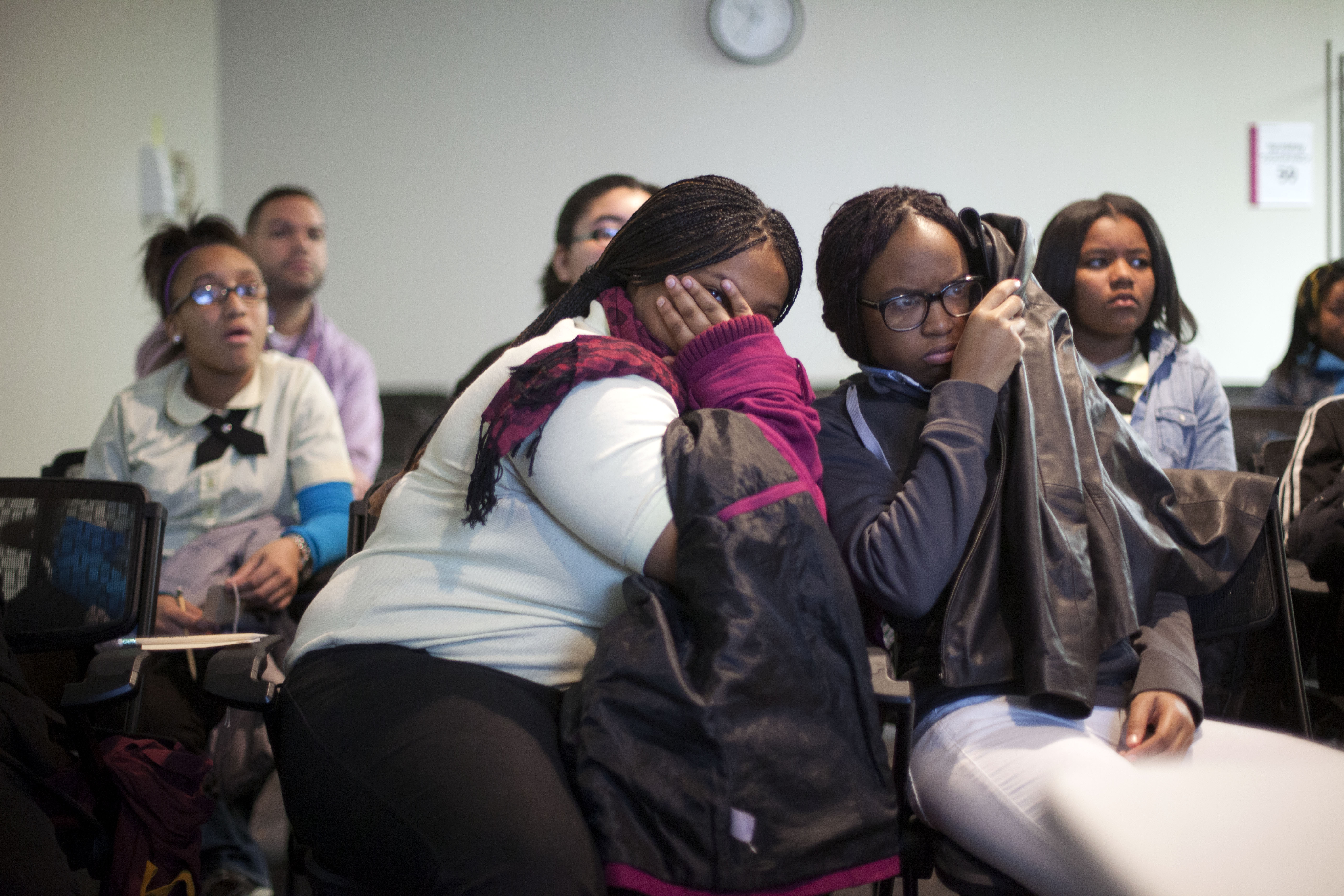 A group of students reacts to images of gunshot injuries during the Cradle to Grave program at Temple University Hospital.