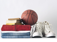 Basketball, with sneakers and a stack of sweats, jeans and books.