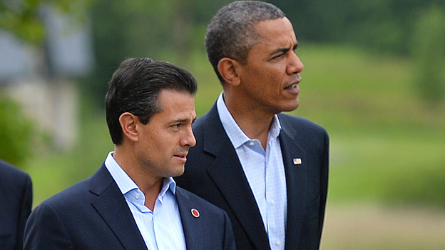 New reports allege that the NSA spied on Mexican President Enrique Pena Nieto, seen here walking with President Barack Obama in June, when he was a candidate for office. Mexico and Brazil have demanded a response to charges of U.S. spying on their internal affairs. (AFP/Getty Images)