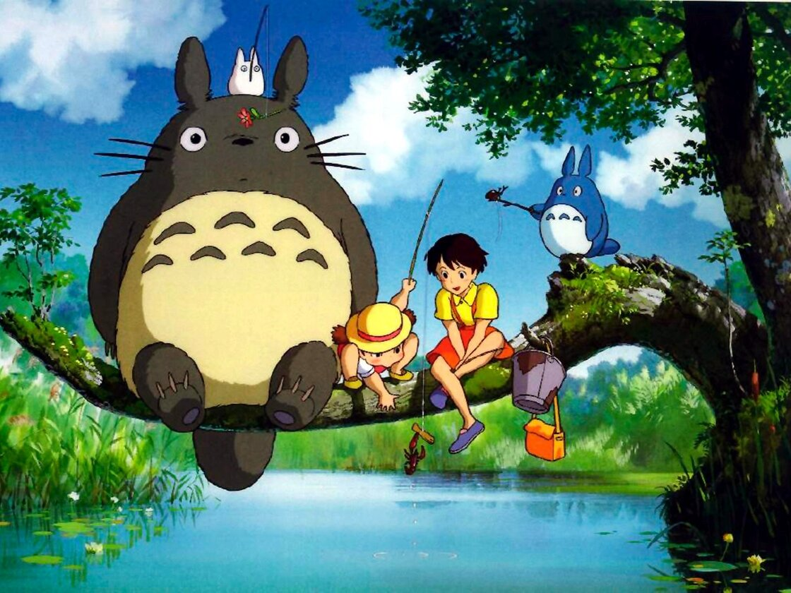 Hayao Miyazaki's film My Neighbor Totoro features the young sisters Mei and Satsuki, seen here sitting next to the whimsical and outsized Totoro.