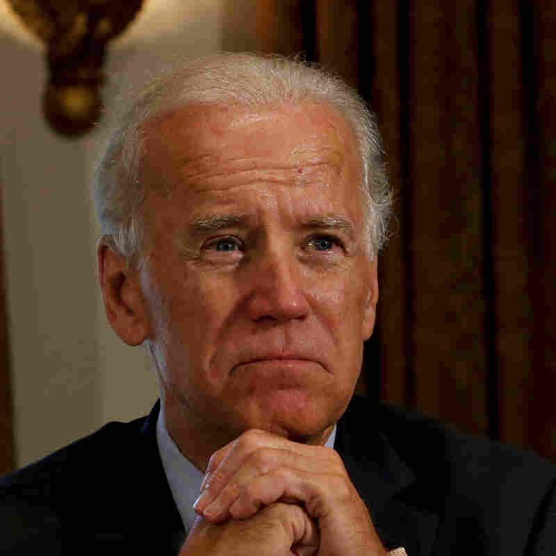 Vice President Joe Biden listens Friday as President Obama speaks at the White House.