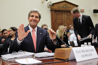 Secretary of State John Kerry waves to members during a hearing on Syria before the House Foreign Affairs Committee on Wednesday in Washington, DC.