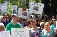 Protesters gathered outside the Yellowstone County Courthouse in Billings, Mont., on Thursday, call for the resignation of a state judge over comments he made about the teenage victim in a rape case.
