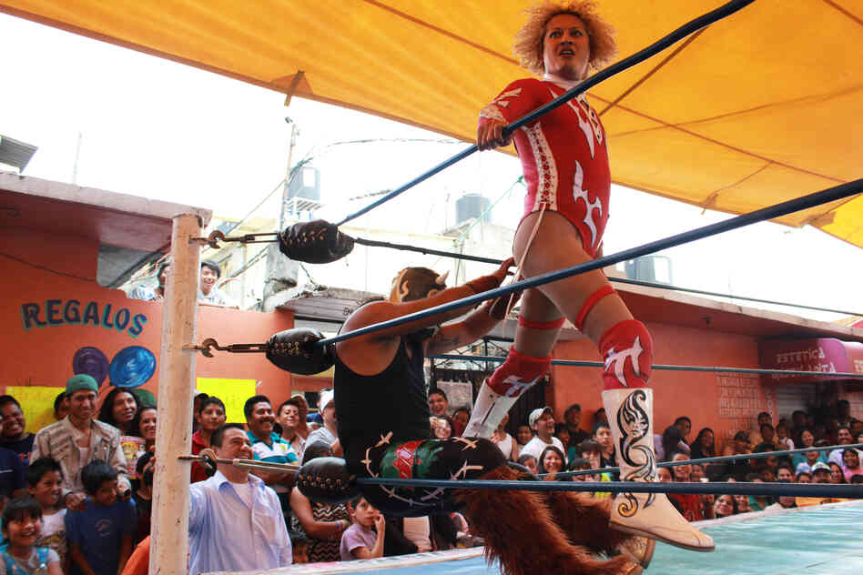 Pasión Kristal performs a signature move on an opponent in Magdalena Culhuacán, on the outskirts of Mexico City. Gabriel Centella Damian wrestles as an Exótico — campy male, mostly gay, professional wrestlers — under the stage name Pasión Kristal. Despite their makeup and feminine clothes, Exóticos are some of the best wrestlers.