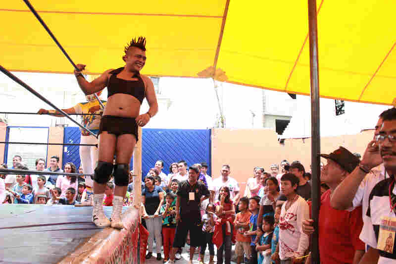 Filmmaker Michael Ramos admits the stereotyping Exóticos revel in is problematic. Exóticos' overt homosexuality generally serves as comic relief. The fight at Magdalena Culhuacán opened with Exótico Juana La Loca, who warmed up the crowd strutting, blowing kisses and flirting with his opponent.