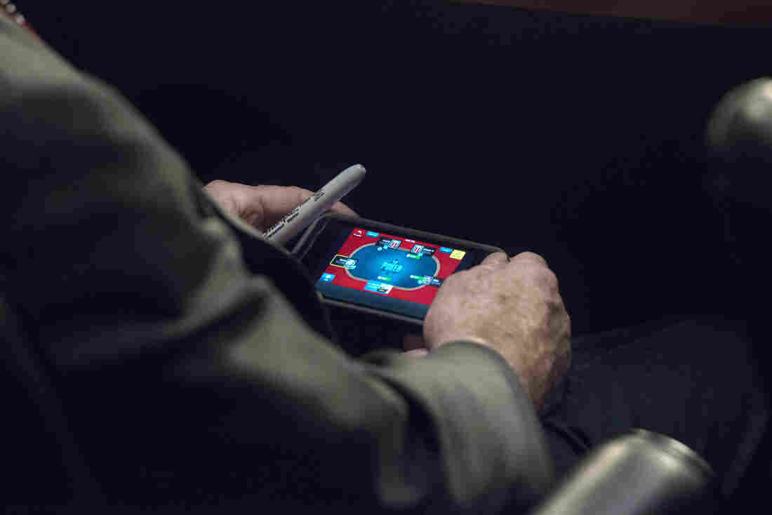 Those are the hands and phone of Sen. John McCain, R-Ariz. He gets bored sometimes, the lawmaker says. So, during a Senate Foreign Relations Committee hearing Tuesday, he played a little poker.
