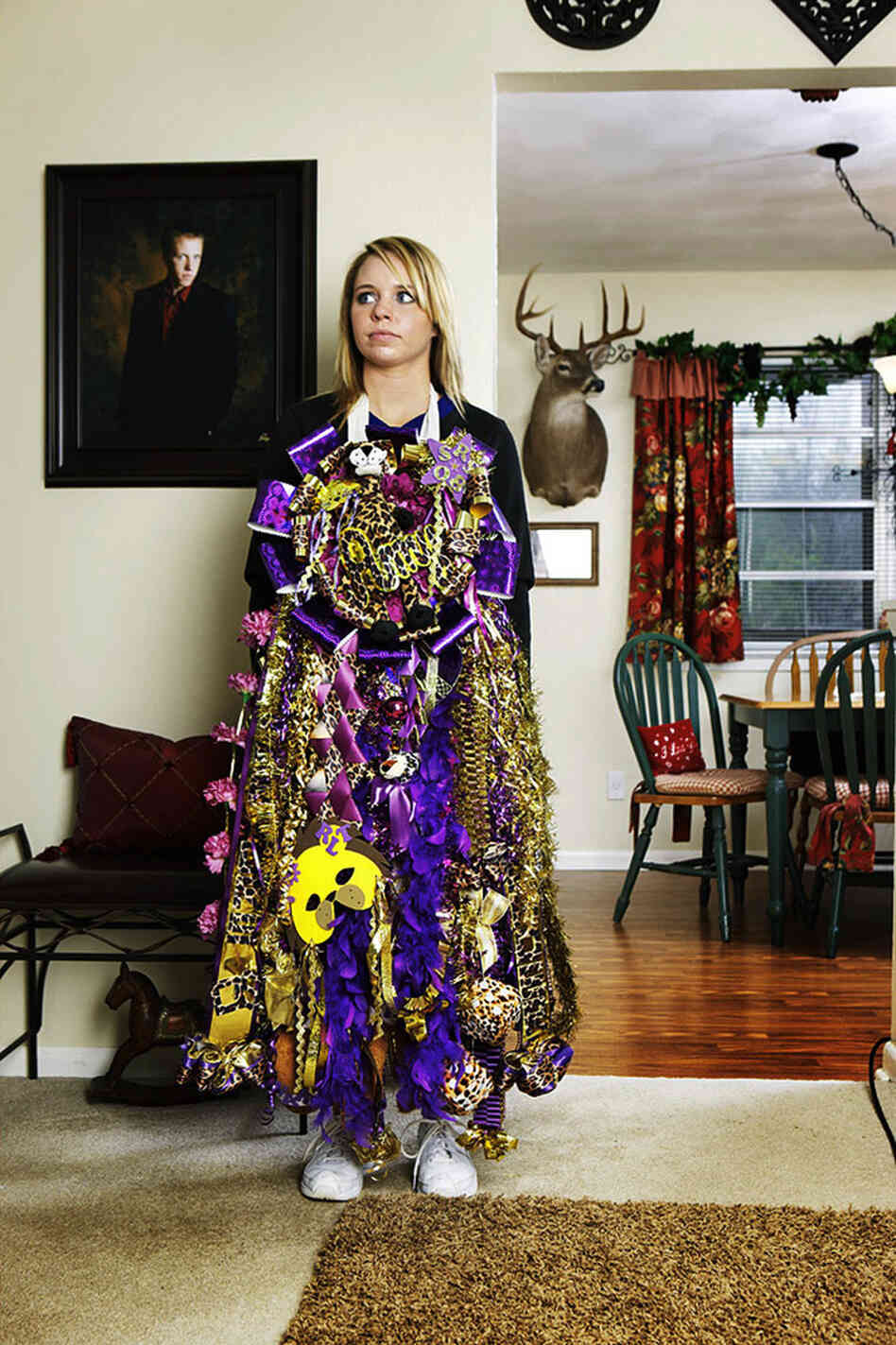 "Photographer Nancy Newberry says times have changed since she wore a ""mum"" (or corsage) in high school in Texas: ""I had no idea that they were this big,"" she says, recalling the moment when she took this photo. ""It totally engulfed her. It looked like some sort of tribal dress or gown."""