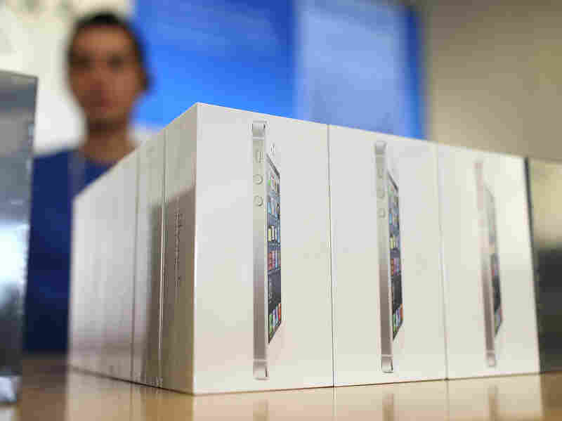 Boxes of the new iPhone 5 are displayed at an Apple Store. On Craigslist, used, empty boxes are offered for at least $10.