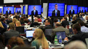 Reporters watch the final minutes of the presidential debate between President Obama and Republican presidential nominee Mitt Romney last October in Denver.