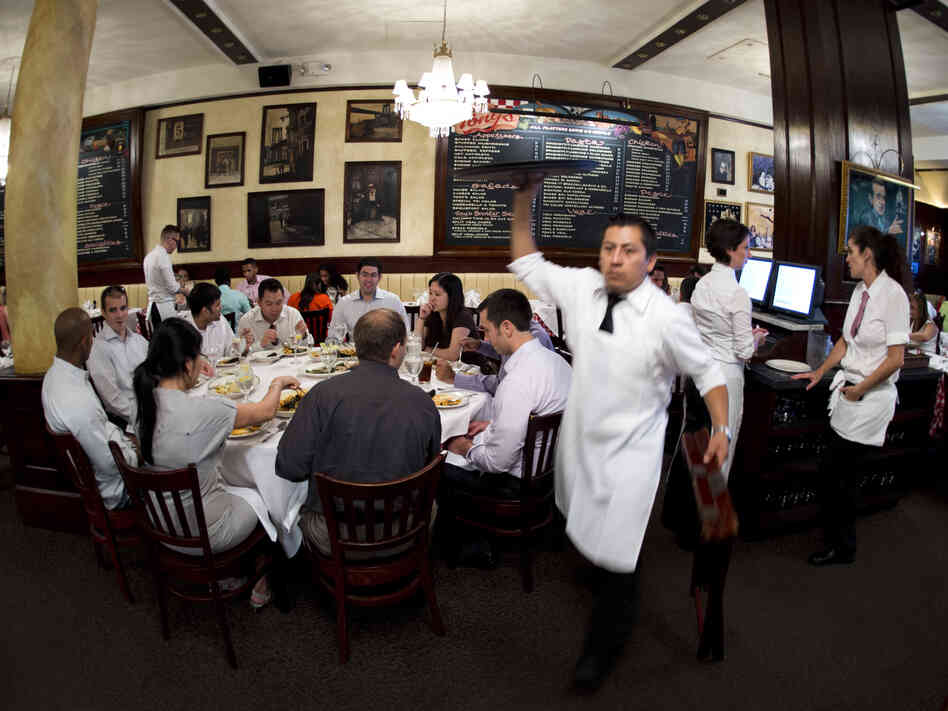 A waiter serves patrons at Tony's Restaurant, part of the Casablanca H