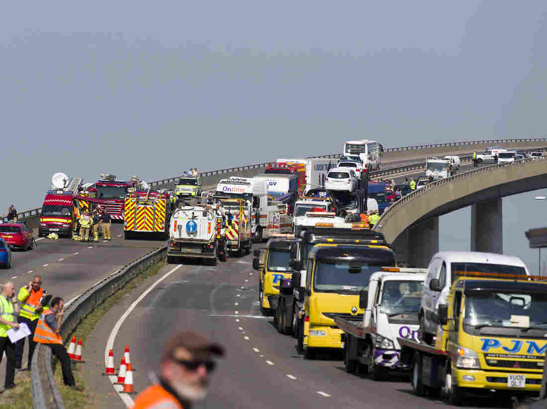 Recovery workers vehicles back the front of the Sheppey crossing bridge after 100 or more vehicles were involved in a major road traffic incident in Sheppey, Kent, southeast England on Thursday.