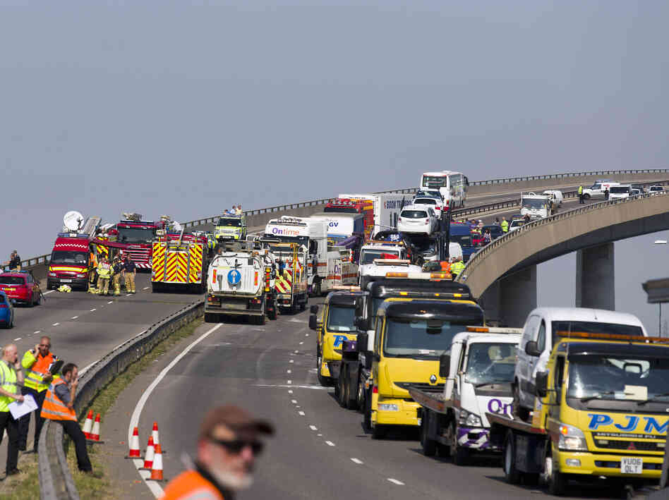 Recovery workers vehicles back the front of the Sheppey crossing bridge after 100 or more vehicles were inv