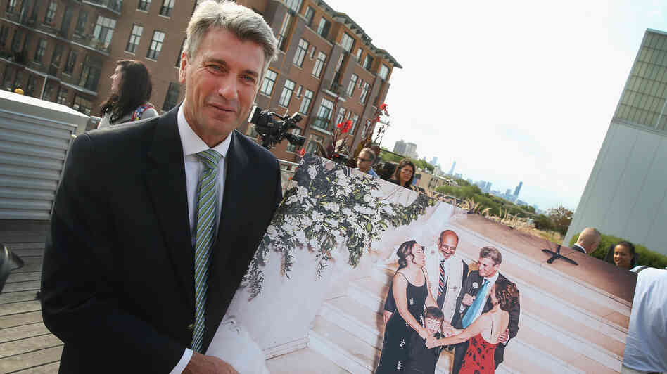 Minneapolis Mayor R.T. Rybak visits Chicago Thursday to invite gay couples to tie the knot in his city. Here, he shows a picture taken while he officiated a same-sex marriage in Minnesota.